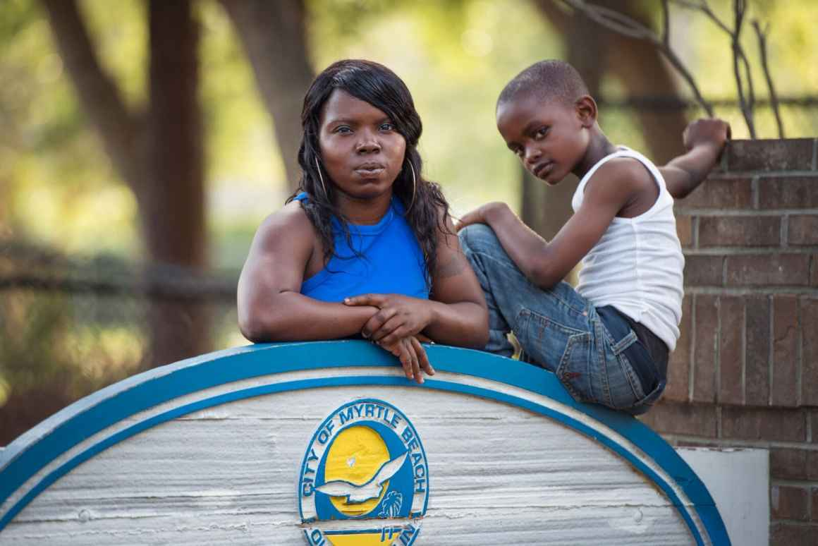 Plaintiff Cayeshia Johnson with her son at the playground