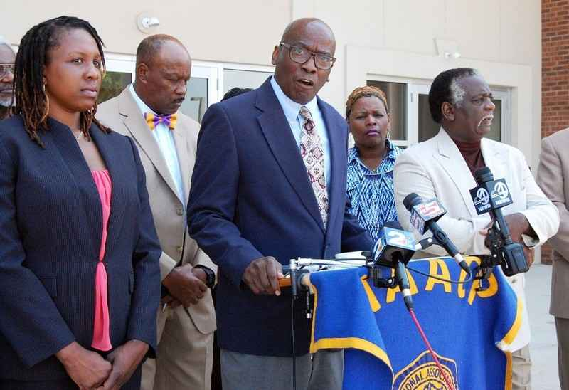 Civil rights leaders at speaking at press conference