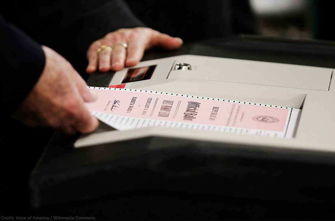 A ballot is entered into a machine at a polling site