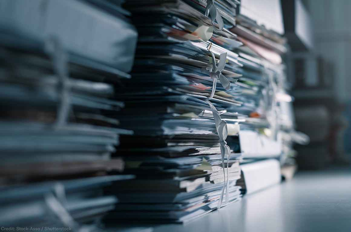 Stacks of files in a dark office