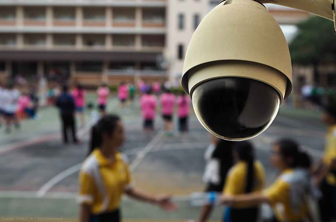 Surveillance camera mounted in front of a school yard