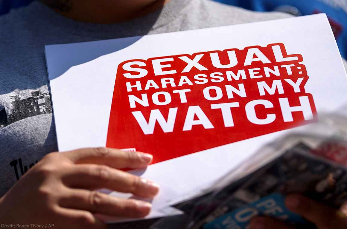 "Protester holding sign stating ""Sexual Harassment: Not on my Watch"
