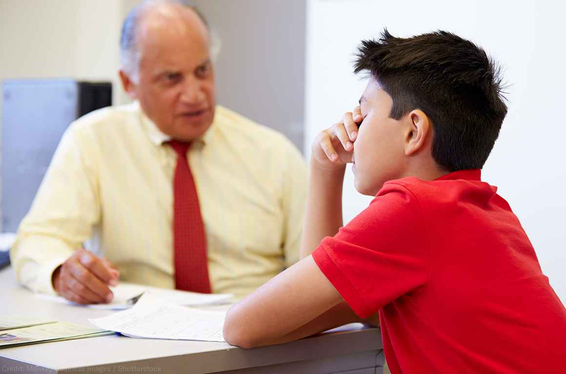 Distressed student sitting with a counselor